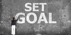 Woman drawing set goal